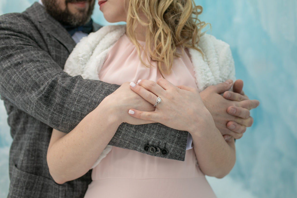 close up of arms and hands, ice castle engagement
