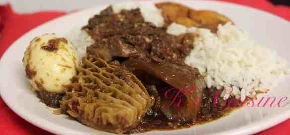 Ayamashe served with rice, plantain and assorted meats