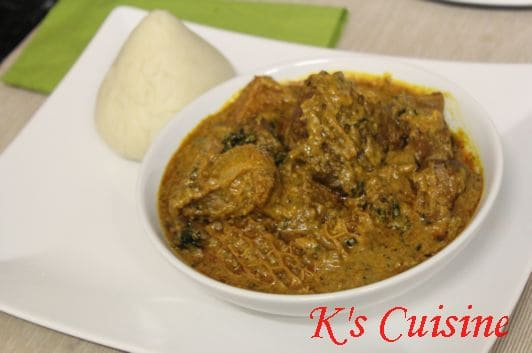 Groundnut soup with cone shaped pounded yam