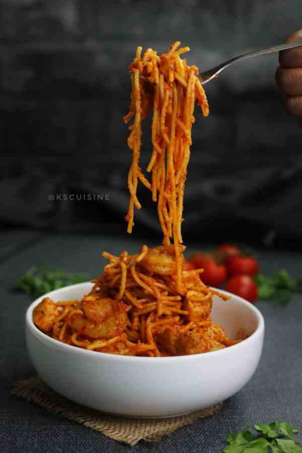 Jollof spaghetti cooked in tomato sauce. jollof spaghetti picture. best nigerian food photography