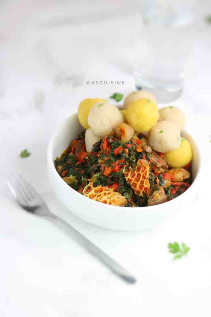 Two tones eba and efo riro served with fork on the side