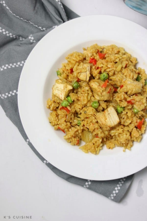 chicken paella served on white plate