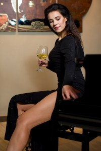 Girl playing with Piano in a sexy and Glamour pose