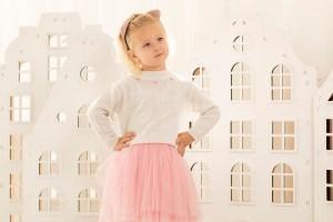 Beautiful little girl posing for children fashion Lookbook