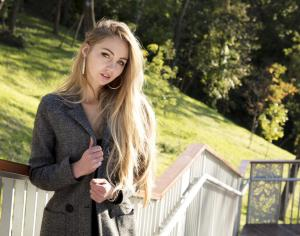 Beautiful Blond girl portrait in Park