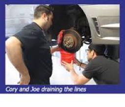 cory-and-joe-draining-the-linesStop-Tech WRX Big Brake Kit