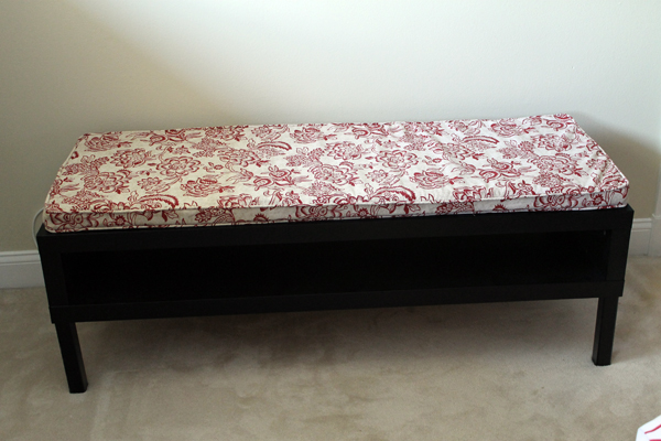 Former coffee table turned into bench with cushion.