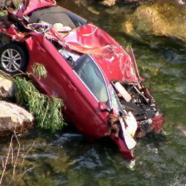 Officials executed a recovery operation on Sept. 1, 2017, to extract two bodies from a 2016 Hyundai Sonata that has been stuck against a rock since late July. (Credit: Fresno County Sheriff's Office Search and Rescue)