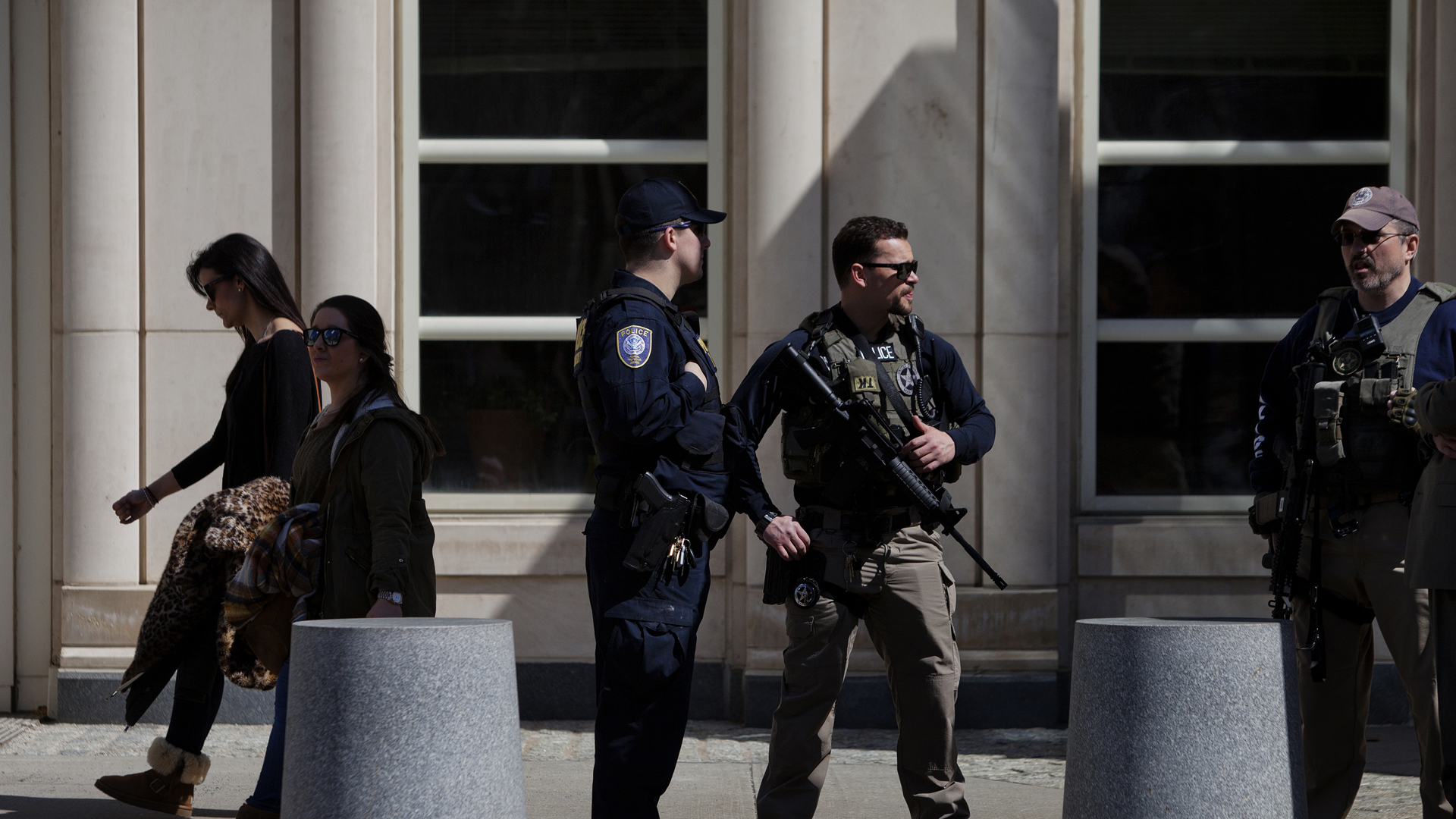 U.S. Marshals stand outside U.S. Federal Court in Brooklyn, New York, during the arraignment on terrorism charges against Muhanad Mahmoud al Farekh, and two Queens women, on April 2, 2015. (Credit: Victor J. Blue/Getty Images)