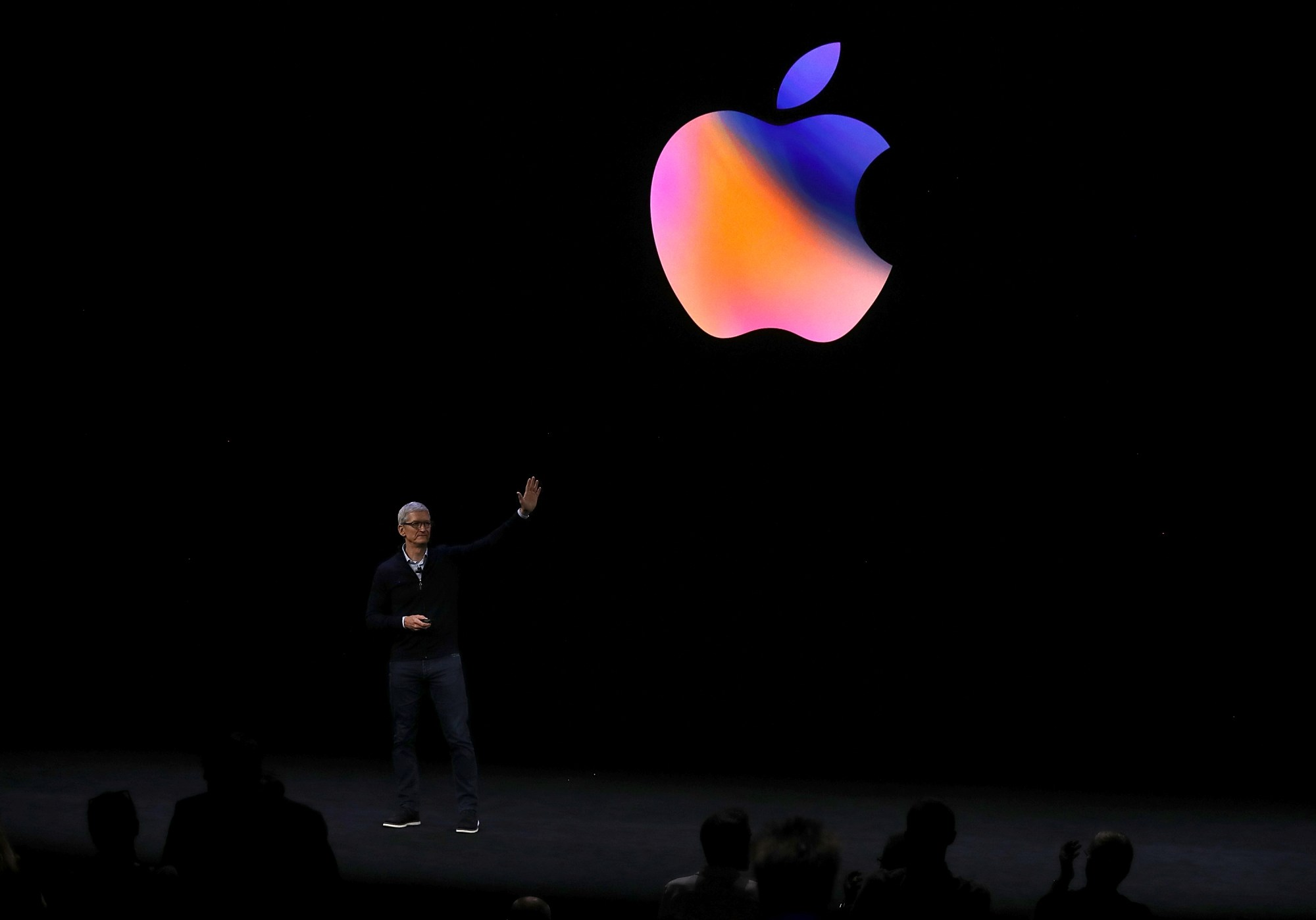 Apple CEO Tim Cook waves to the audience during an Apple event at the Steve Jobs Theatre on the Apple Park campus on Sept. 12, 2017 in Cupertino. (Credit: Justin Sullivan/Getty Images)