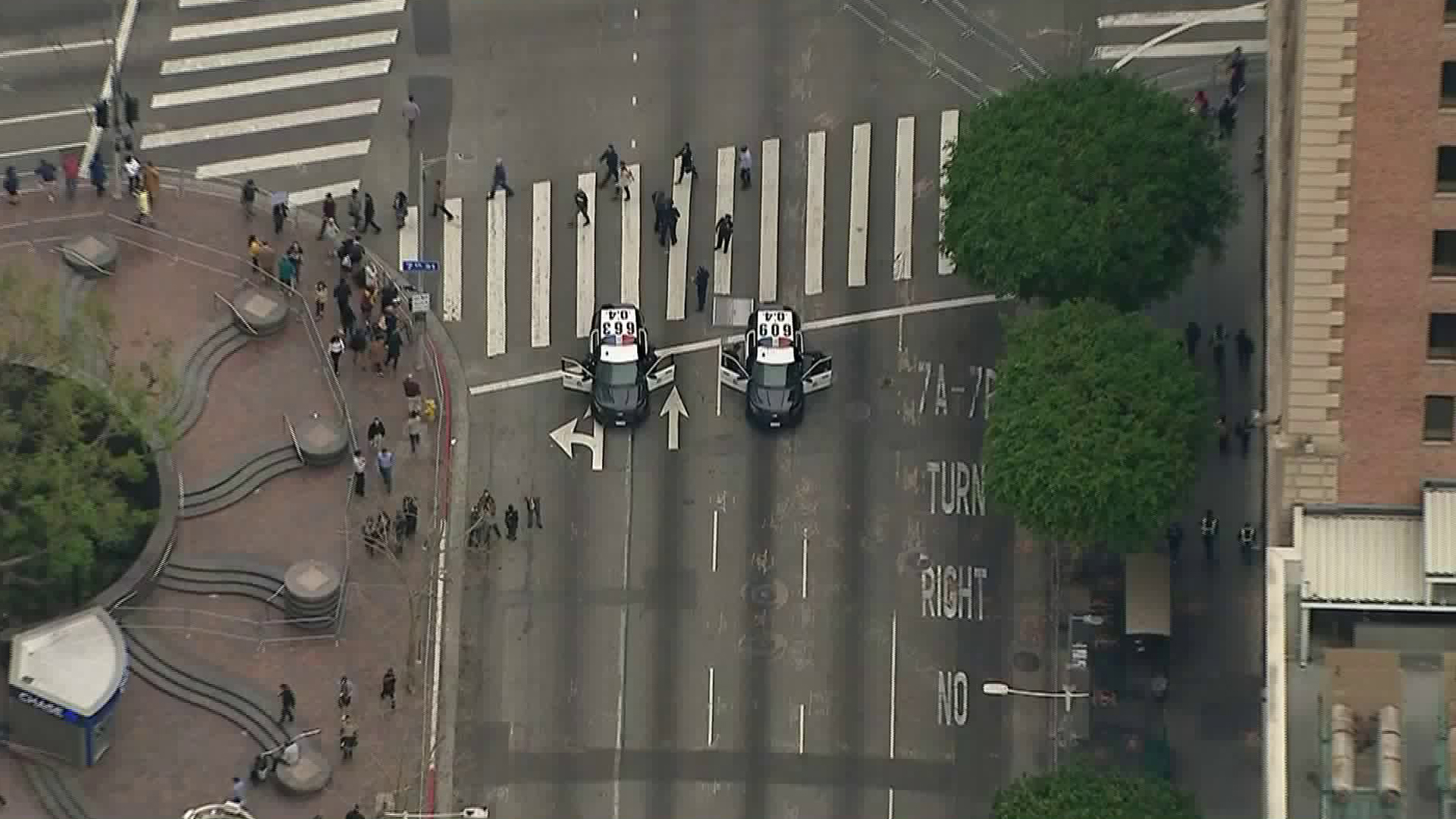 LAPD officers block traffic in downtown Los Angeles on March 13, 2018, in advance of President Trump's visit. (Credit: KTLA)