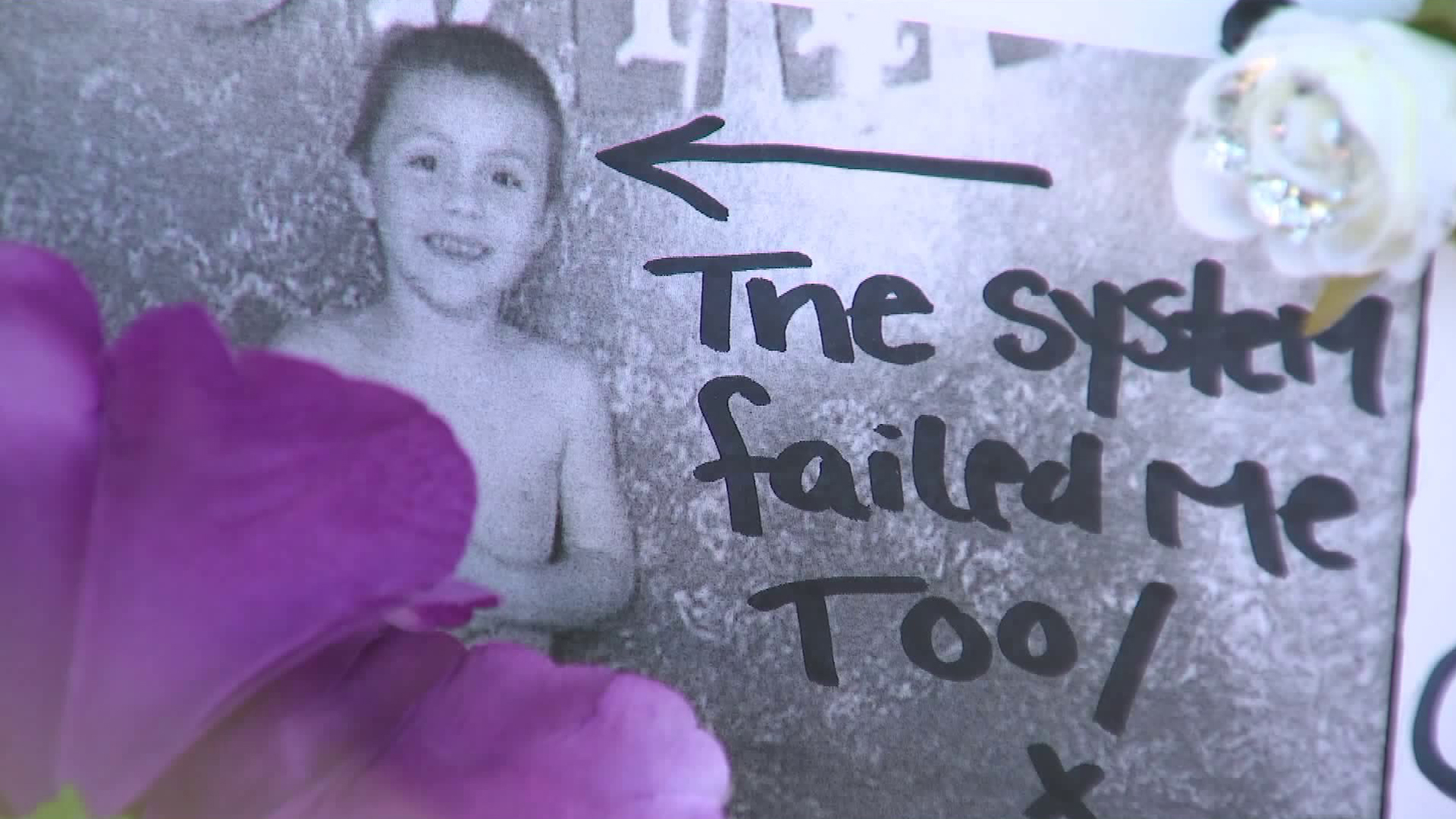 """An undated photo of Anthony Avalos with the words """"the system failed me too"""" is displayed at a vigil held to remember him in Lancaster on June 22, 2018. (Credit: KTLA)"""