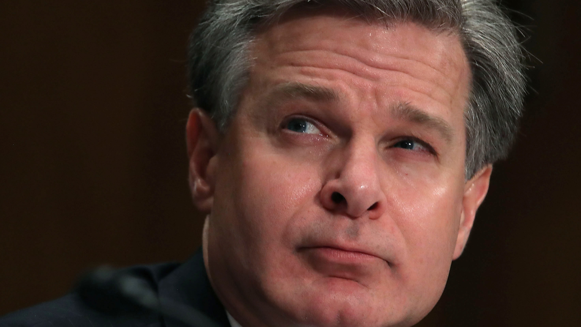 FBI Director Christopher A. Wray listens to comments during a Senate Homeland Security and Governmental Affairs Committee hearing on Capitol Hill, on Oct. 10, 2018. (Credit: Mark Wilson/Getty Images)