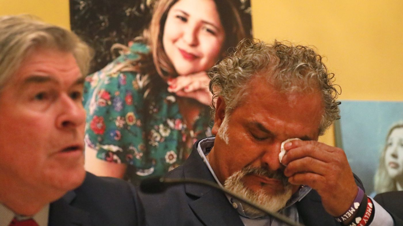 Salvador Albert Corado, father of Melyda Corado, who was shot and killed by LAPD officers at a Trader Joe's in Silver Lake, during a press conference with a family attorney, John Taylor. Melyda's photo is in the background. (Credit: Al Seib / Los Angeles Times)