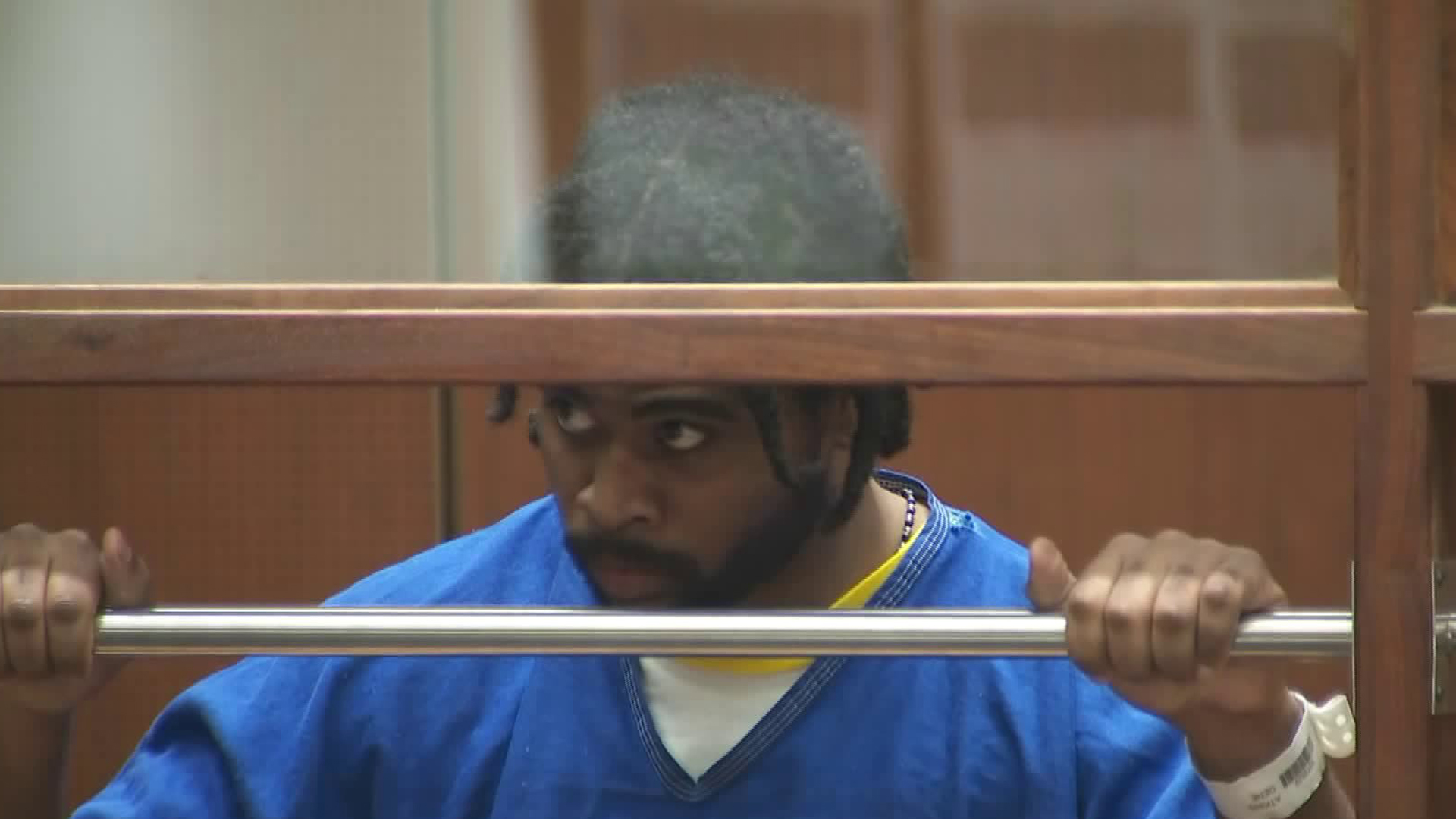 Gene Atkins, 28, appears in Los Angeles County Superior Court on Nov. 7, 2018, where he was expected to be arraigned on murder and other charges in connection with a shootout with police outside a Trader Joe's store that left one woman dead in July 2018. (Credit: KTLA)