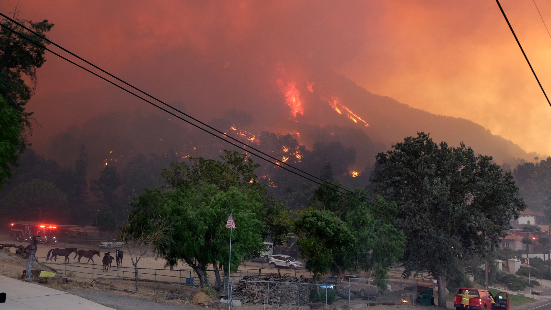 Firefighters work to protect structures as the Woolsey Fire burns near Paramount Ranch on November 9, 2018 in Agoura Hills. (Credit: Matthew Simmons/Getty Images)