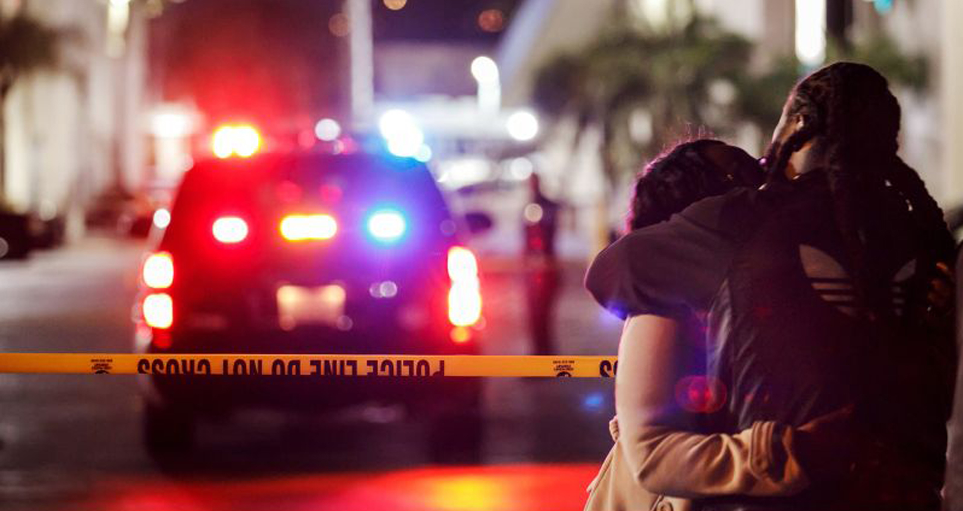 People console each other outside the Gable House Bowl bowling alley in Torrance after a fatal shooting occurred on Jan. 4, 2019. (Credit: Marcus Yam / Los Angeles Times)