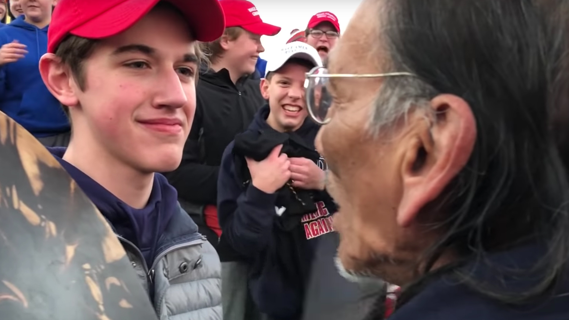 A screenshot from a video posted to YouTube on Jan. 18, 2019 by user KC NOLAND shows a boy wearing a MAGA hat in front of a Native American man.