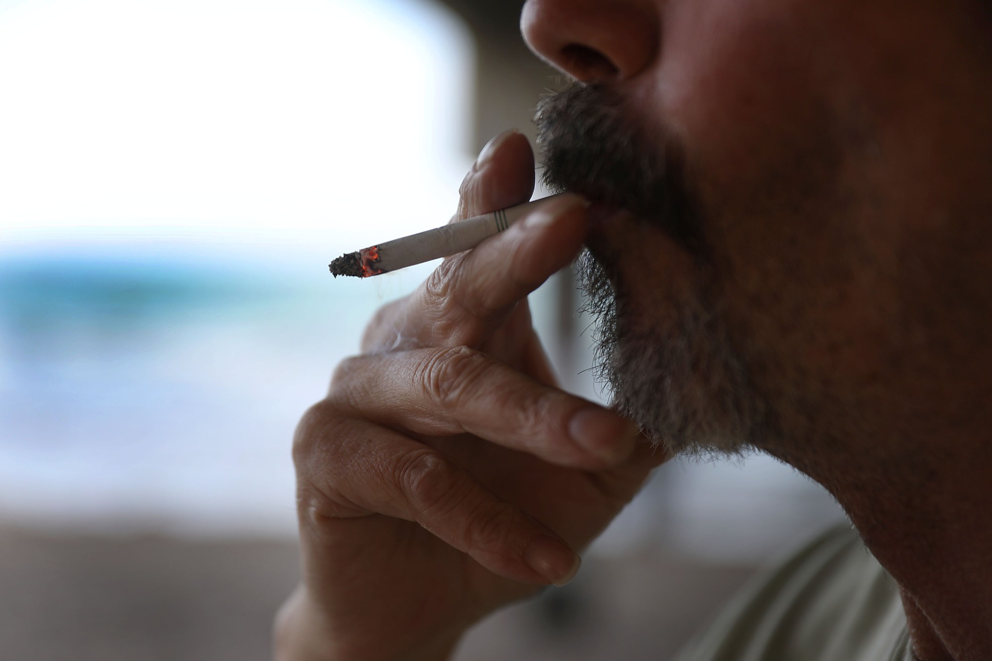 A man smokes a cigarette at Dania Beach, Florida in this Jan. 3, 2019 file photo. (Joe Raedle/Getty Images)