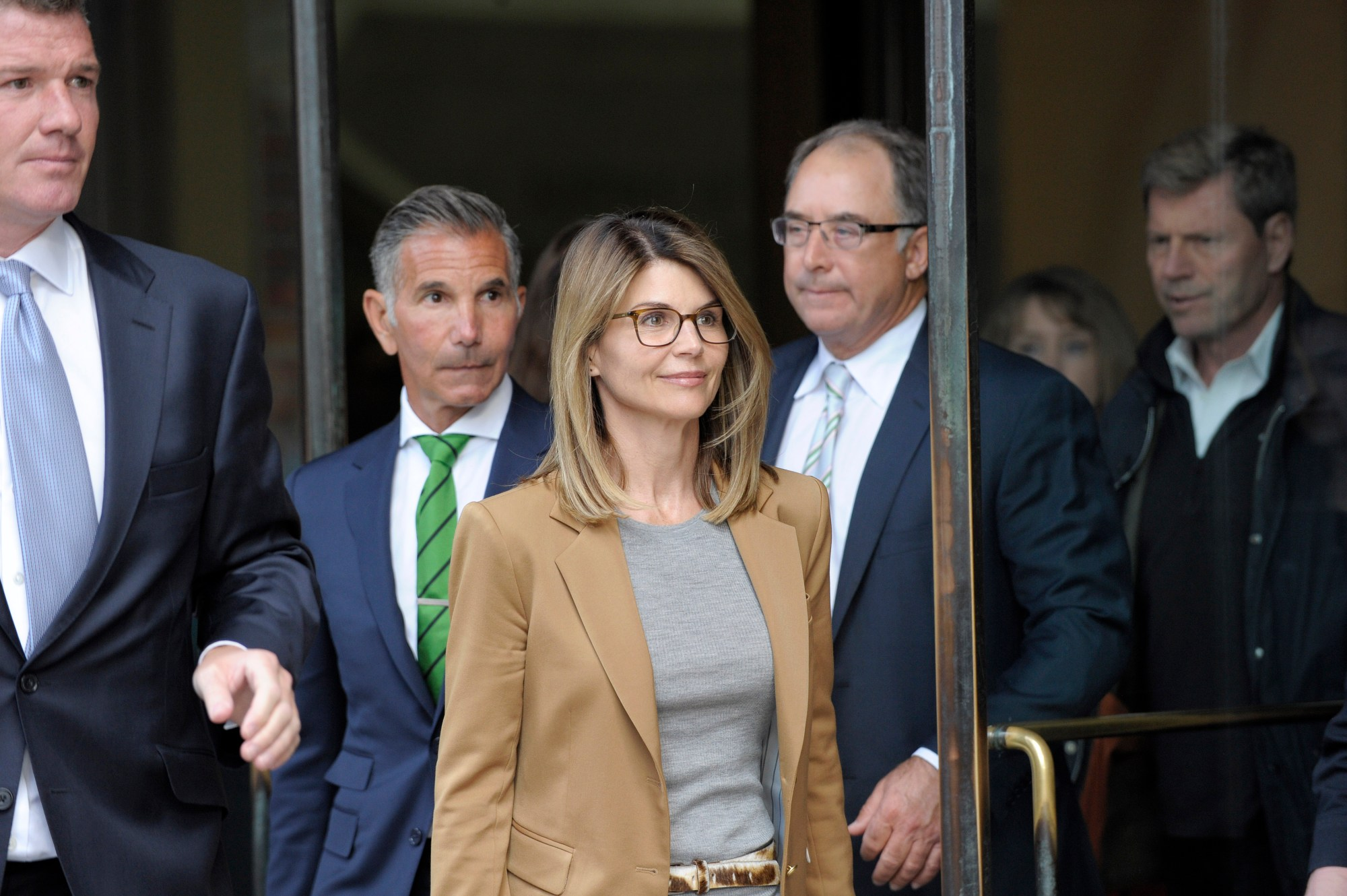 Actress Lori Loughlin exits the courthouse after facing charges for allegedly conspiring to commit mail fraud and other charges in the college admissions scandal at the John Joseph Moakley United States Courthouse in Boston on April 3, 2019. (Credit:JOSEPH PREZIOSO/AFP/Getty Images)