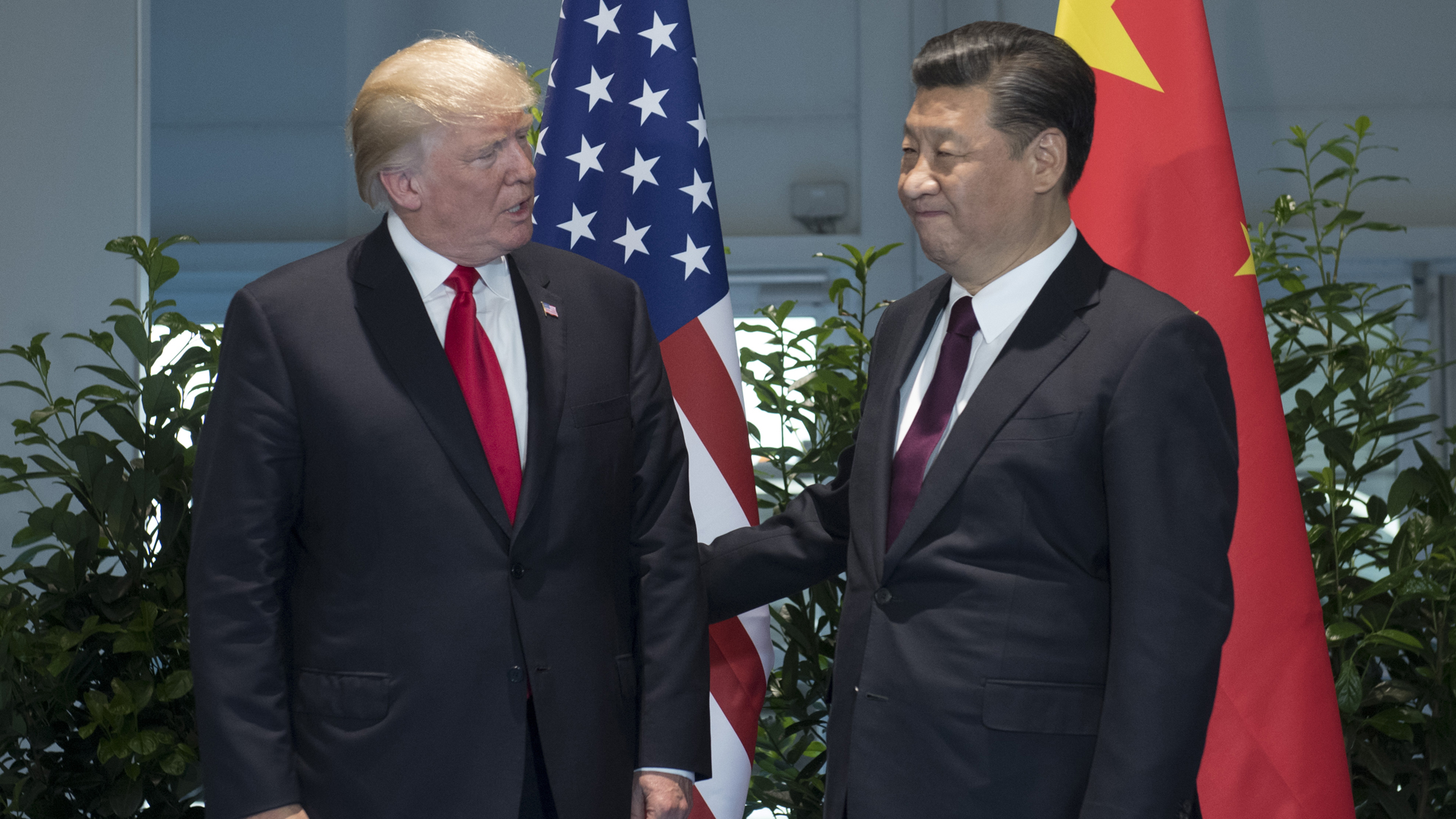 US President Donald Trump and Chinese President Xi Jinping (R) pose prior to a meeting on the sidelines of the G20 Summit in Hamburg, Germany, July 8, 2017. (Credit: SAUL LOEB/AFP/Getty Images)