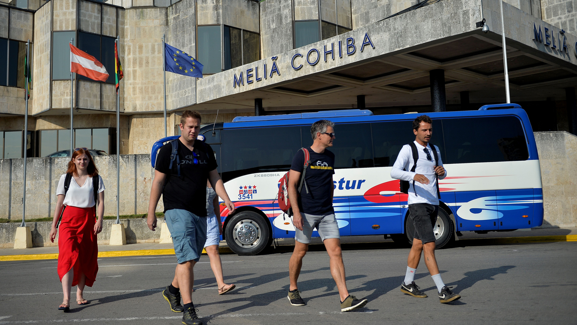 Tourists walk in front of the Melia Cohiba hotel in Havana on May 7, 2019. - Cuba welcomed 1.93 million visitors in the first four months of the year, a seven percent increase on 2018. Tourism represents the second most important economic activity in Cuba, behind medical services. (Credit: Yamil Lage/AFP/Getty Images)