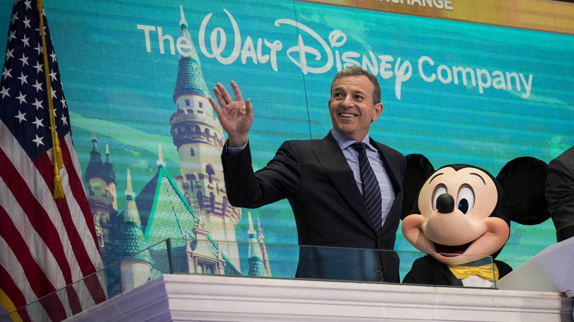 Walt Disney Company CEO Bob Iger and Mickey Mouse look on before ringing the opening bell at the New York Stock Exchange (NYSE), November 27, 2017 in New York City. (Drew Angerer/Getty Images)