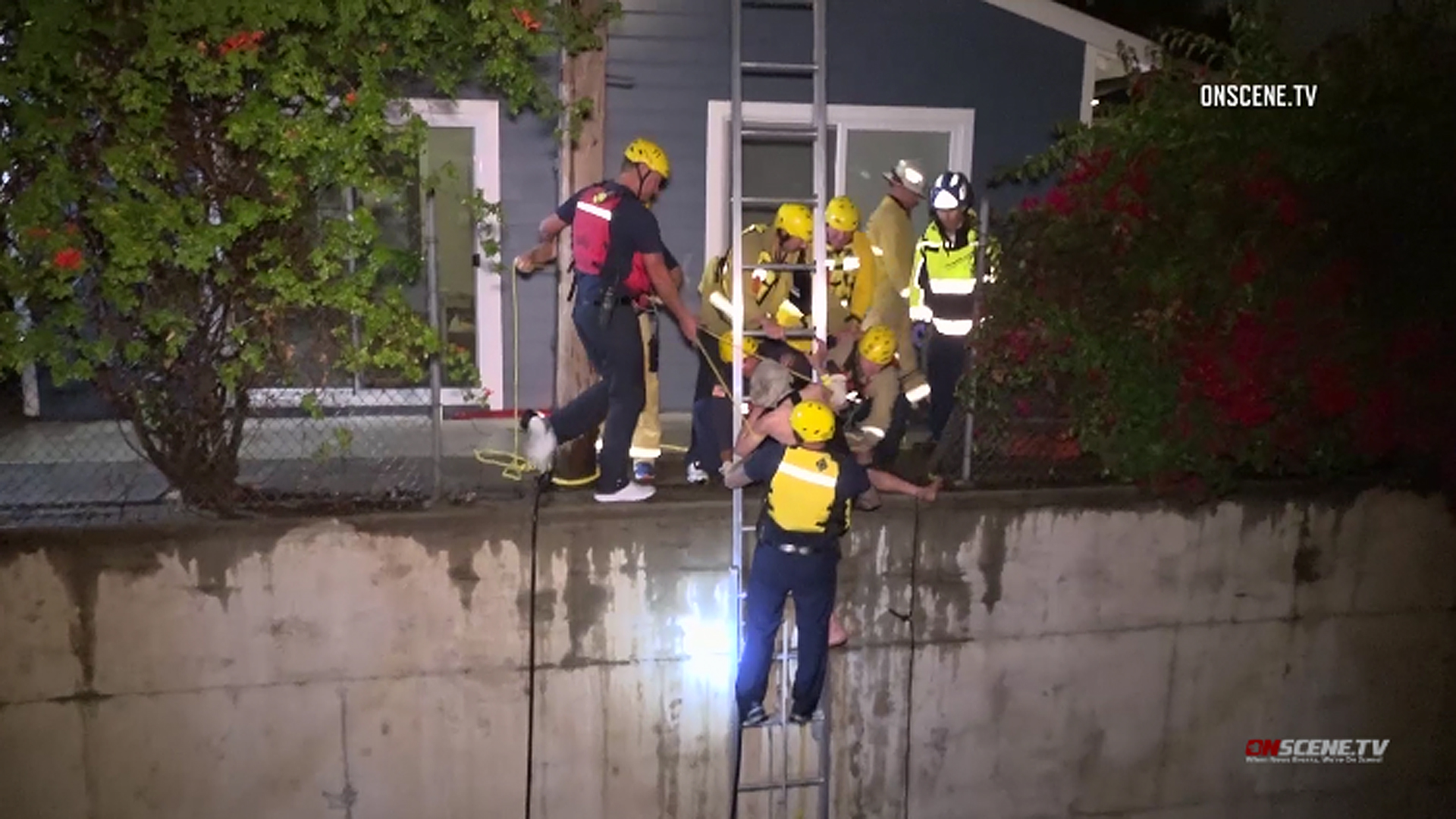 A man is rescued from the rushing waters of a drainage ditch in Fullerton on May 19, 2019. (Credit: OnScene.TV)