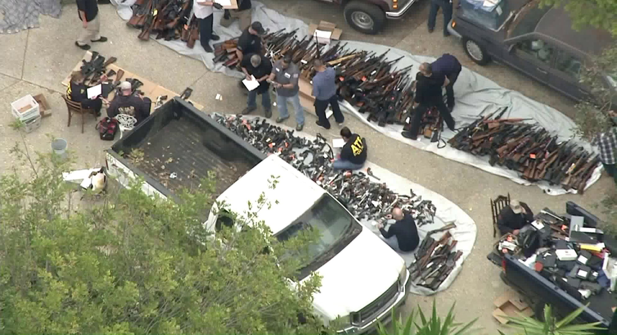 ATF officials investigate after hundreds of guns are found in a Bel-Air home on May 8, 2019. (Credit: KTLA)