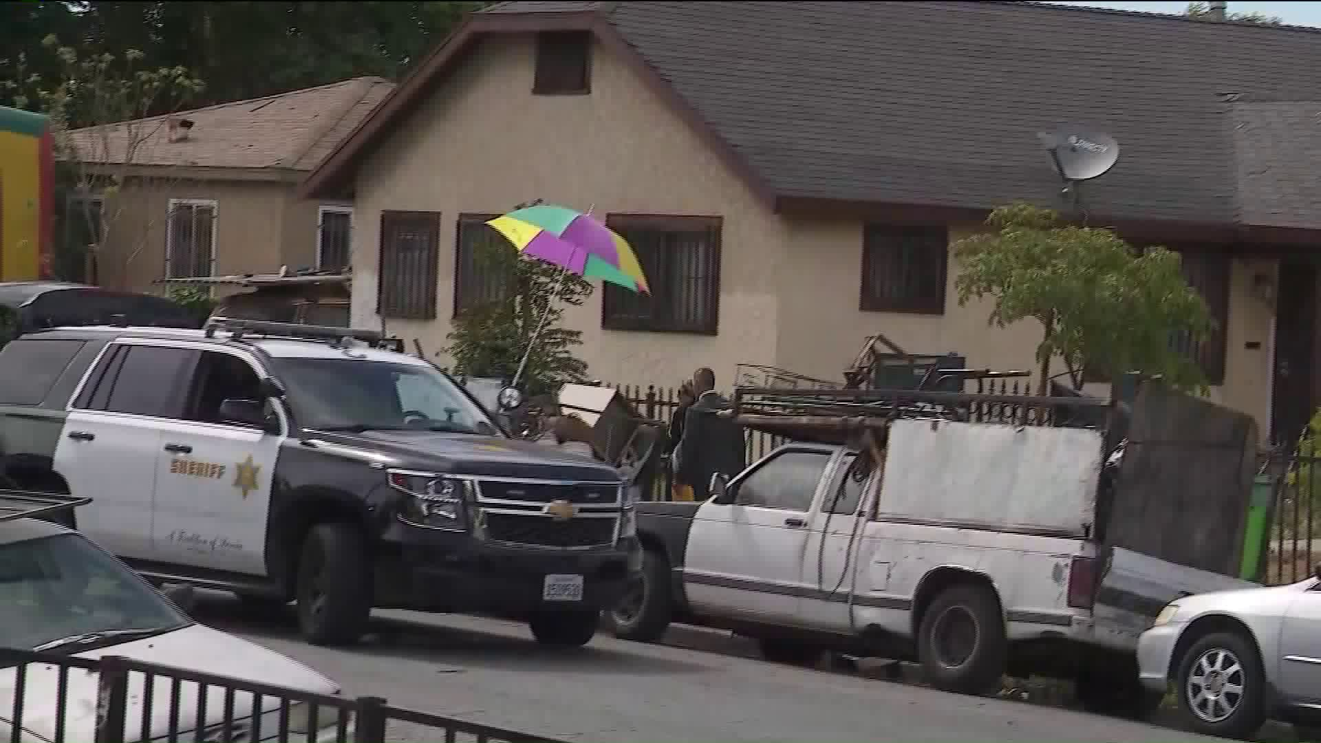 Investigators work at the scene of a fatal stabbing in the 1100 block of East 91st Street in South Los Angeles on June 29, 2019. (Credit: KTLA)