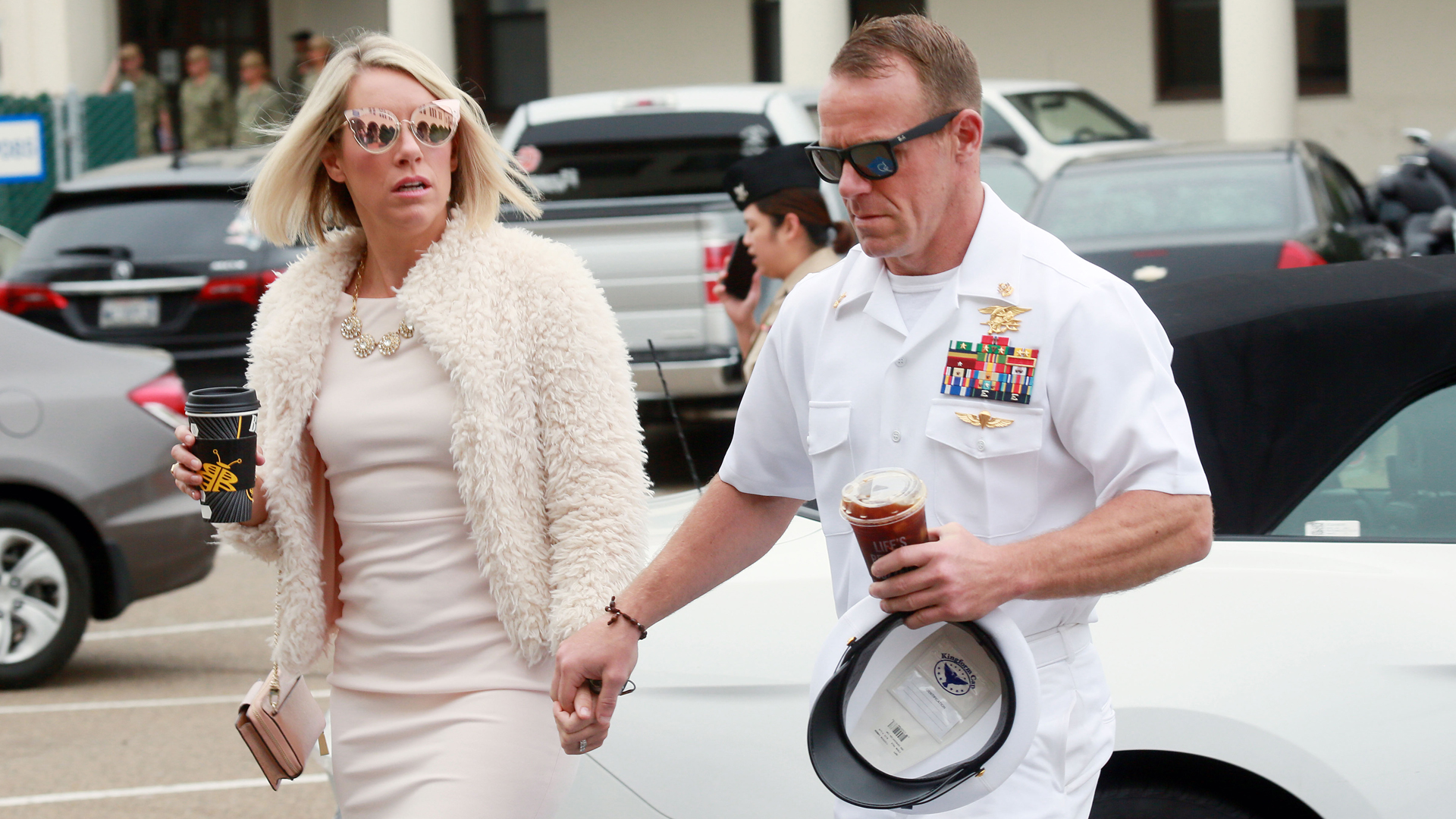 Navy Special Operations Chief Edward Gallagher walks into military court with his wife Andrea Gallagher June 24, 2019, in San Diego, California. (Credit: Sandy Huffaker/Getty Images)