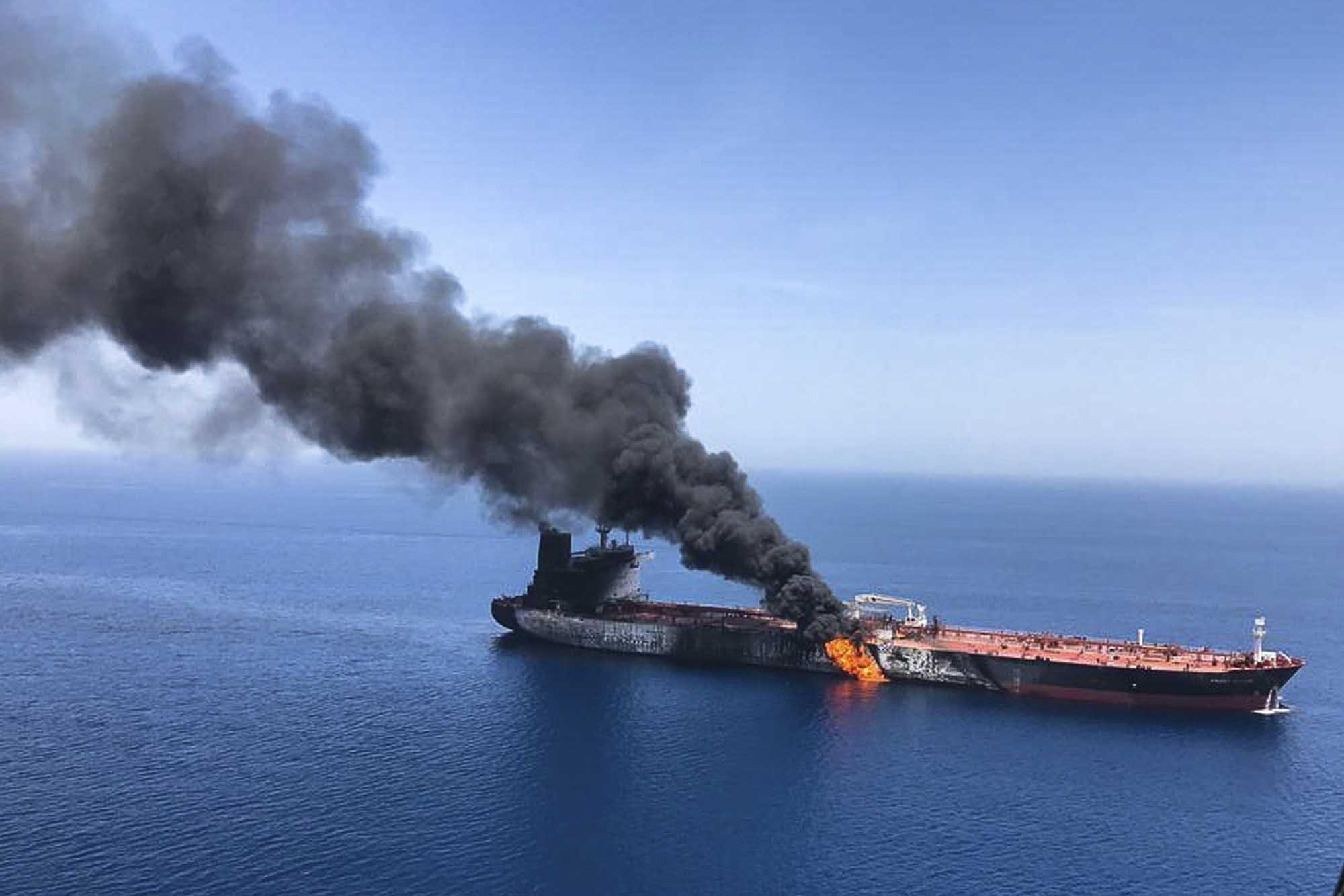 An oil tanker is seen on fire in the sea of Oman on June 13, 2019. (Credit: AP via CNN)