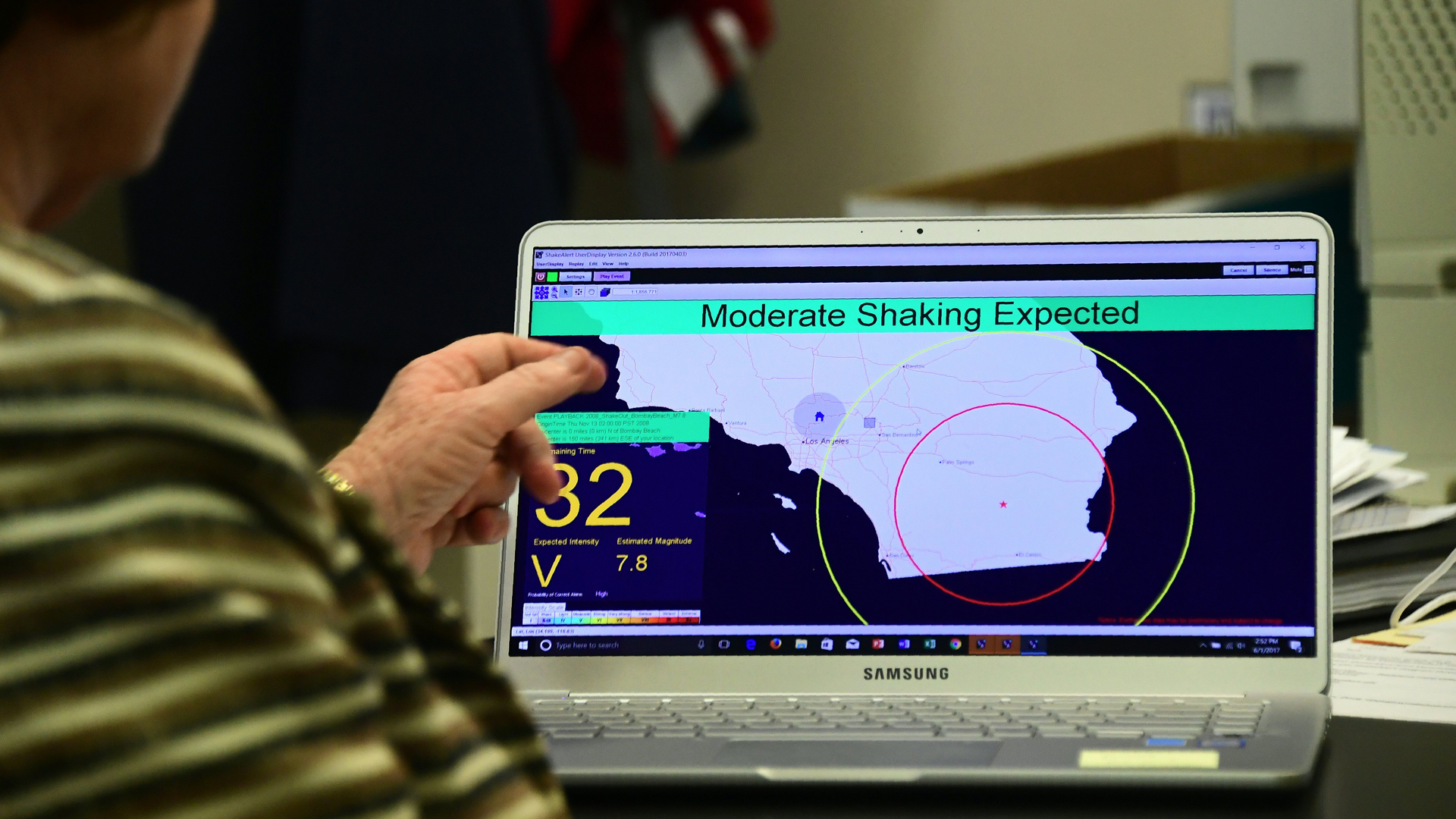 In this file photo, Margaret Vinci, manager of the Seismological Laboratory at Caltech points to a shake alert user display on a laptop screen, set for a limited release on June 1, 2017, at the Caltech Seismological Laboratory in Pasadena. (Credit: FREDERIC J. BROWN/AFP/Getty Images)