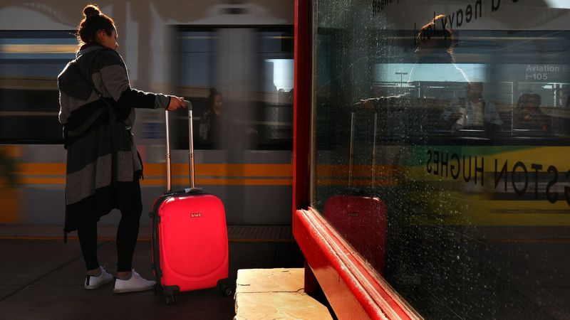 A rider waits to board a train at Aviation/LAX Station in January 2018. The station is one of seven that will be closed during weekends starting July 12. (Credit: Christina House/ Los Angeles Times)