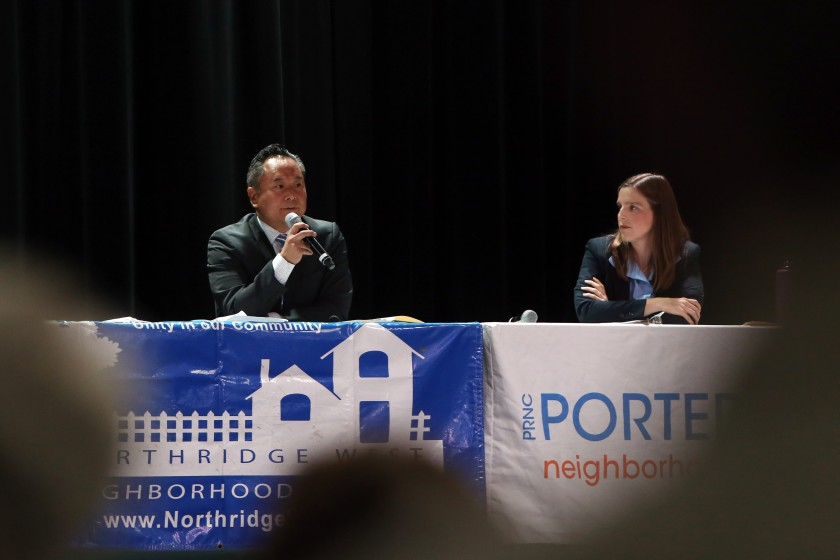 Council candidates John Lee and Loraine Lundquist appear at a town hall meeting in 2019. (Credit: Dania Maxwell / Los Angeles Times)