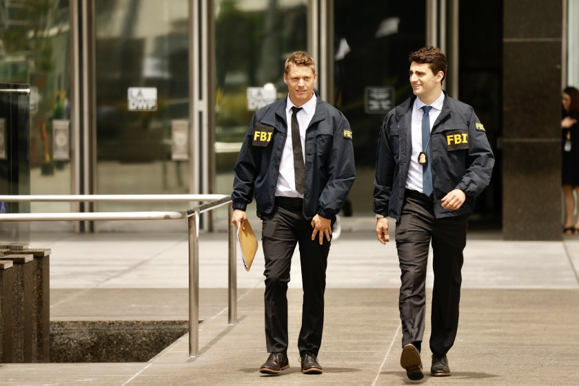 FBI agents leave the downtown headquarters of the Los Angeles Department of Water and Power after serving a search warrant on July 22.(Credit: Al Seib / Los Angeles Times)