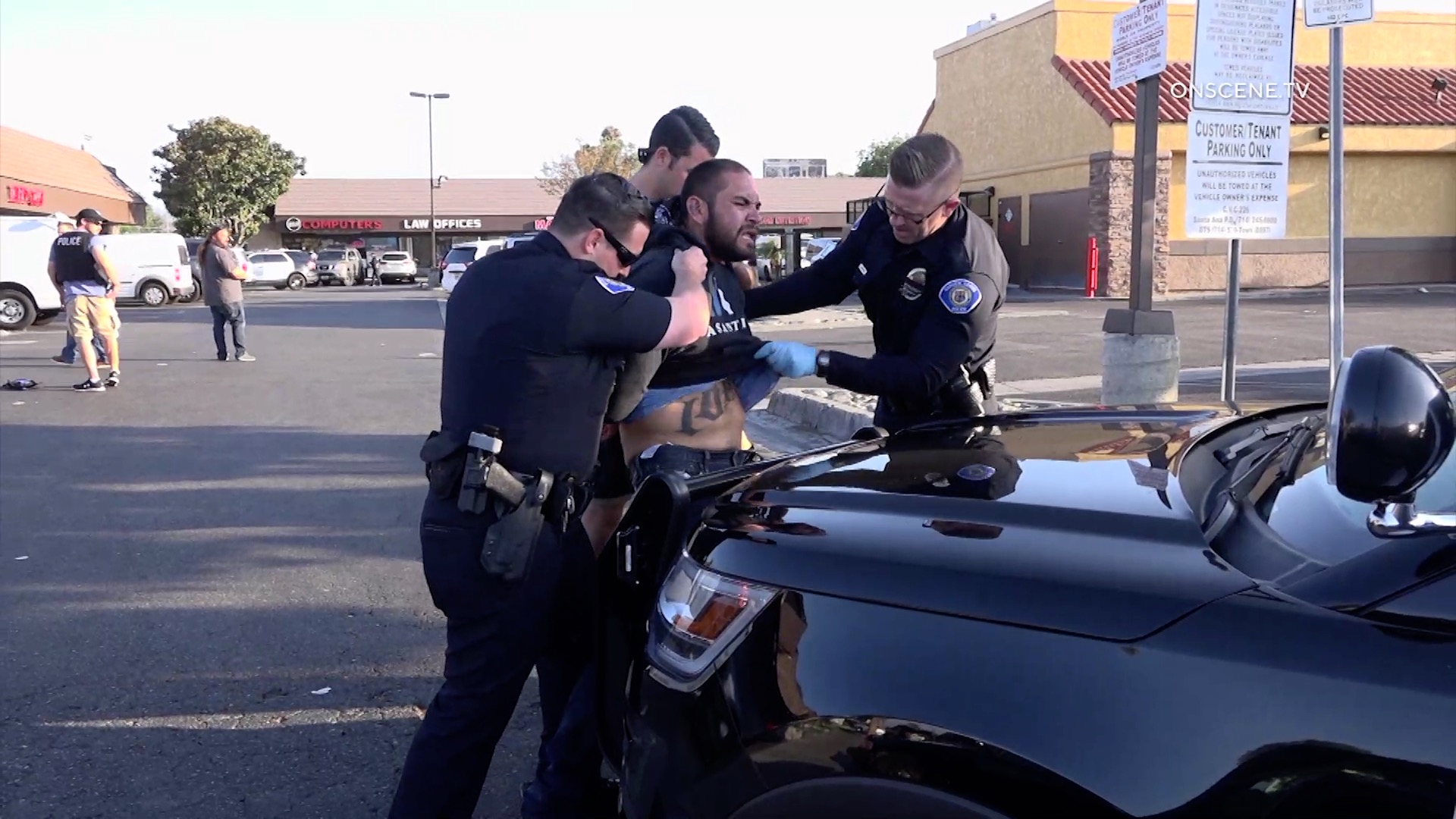Officers handcuff a man suspected in a series of attacks that left at least four people dead in Garden Grove on Aug. 7, 2019. (Credit: OnScene.TV)