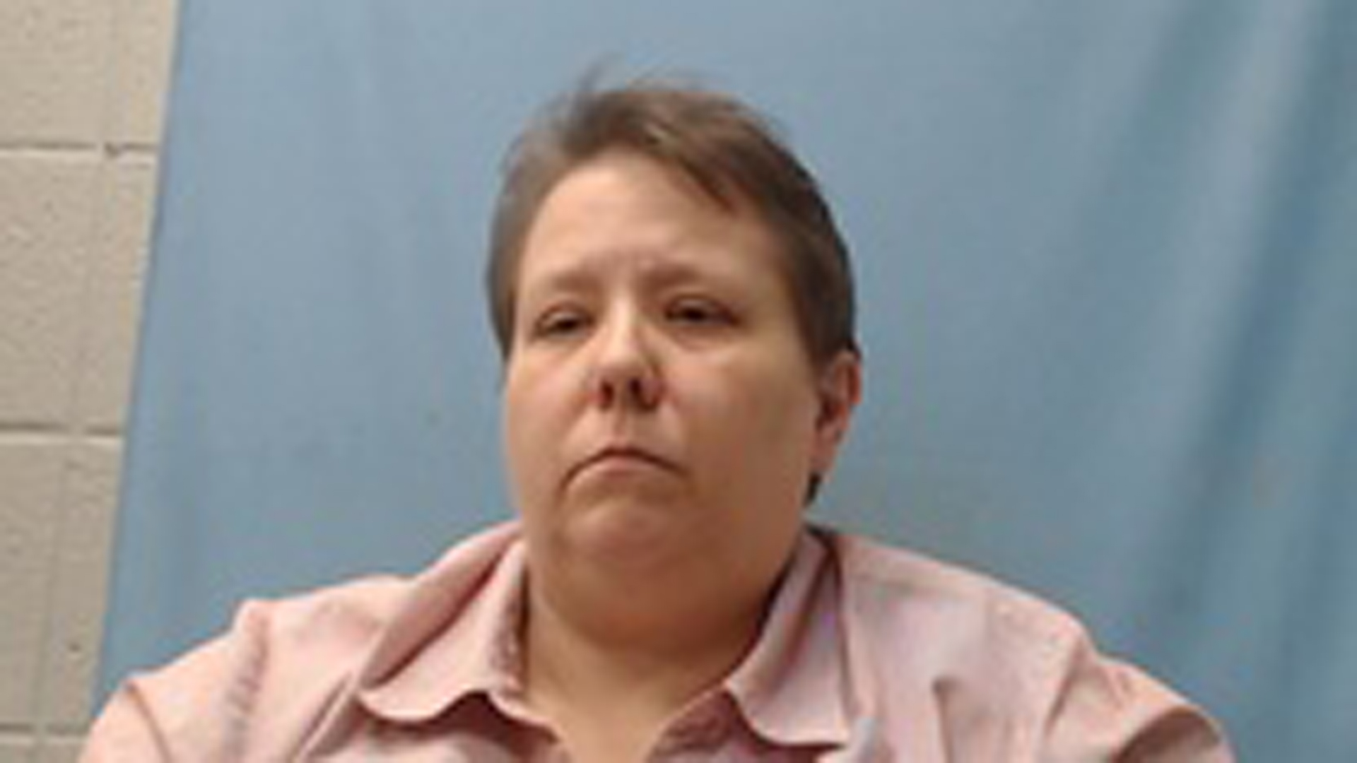 Jerri Kelly is seen in a booking photo released by the Cross County Sheriff's Office.