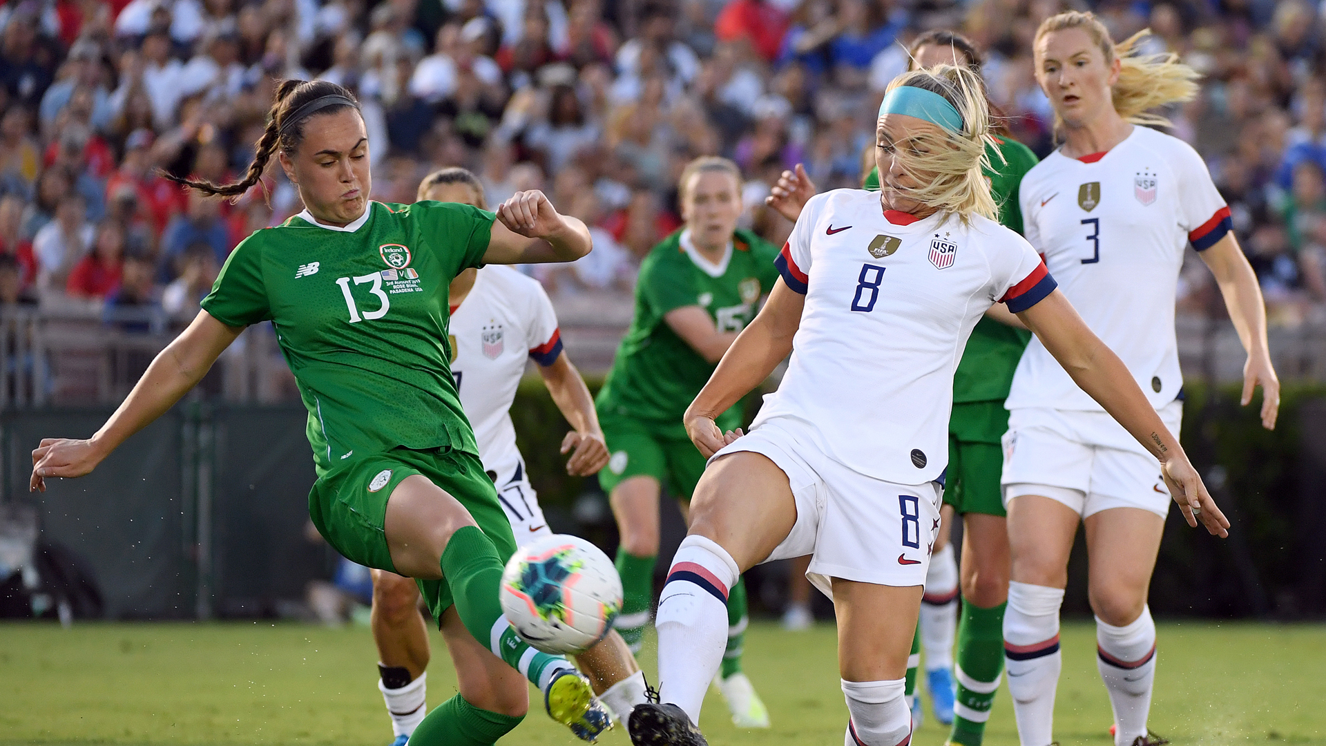 Julie Ertz #8 of the United States and Jess Gargan #13 of the Republic of Ireland go after a ball during the first half of the first game of the USWNT Victory Tour at Rose Bowl on August 03, 2019 in Pasadena, California. (Credit: Harry How/Getty Images)
