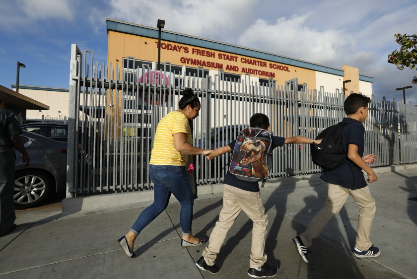 A parent and student are seen outside a charter school in this undated photo. (Credit: (Mel Melcon/ Los Angeles Times)