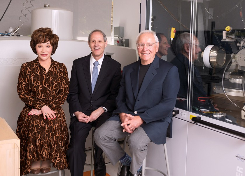 Lynda Resnick, Caltech President Thomas F. Rosenbaum, middle, and Stewart Resnick are seen at a science lab at Caltech in this undated photo.(Credit: Caltech via Los Angeles Times)