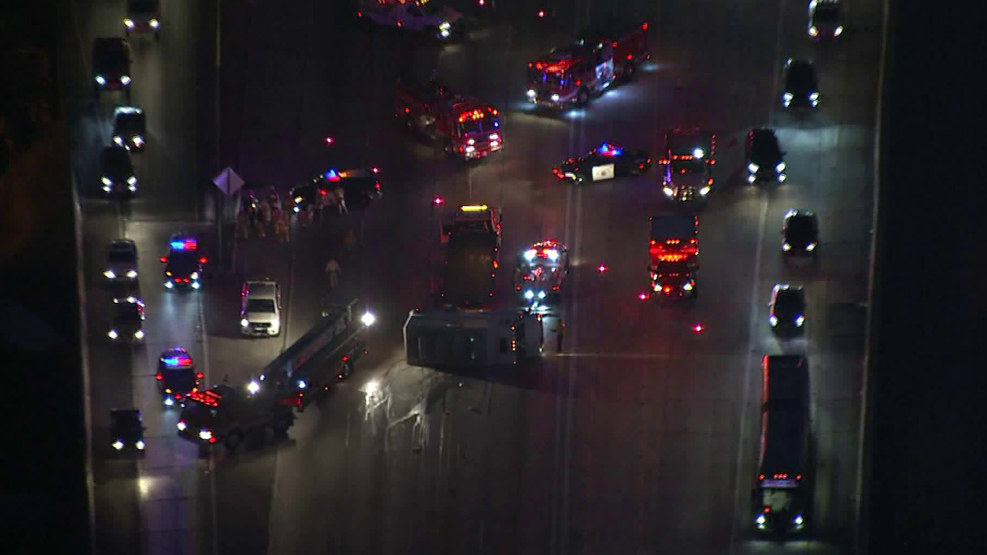 A vehicle appears on its side, blocking lanes on the southbound 110 Freeway, on Oct. 14, 2019. (Credit: Sky5)