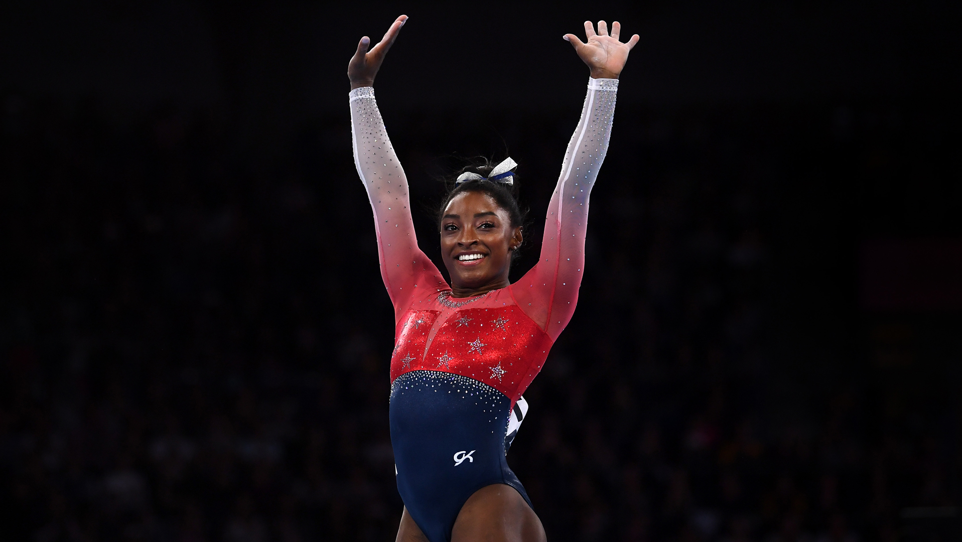 Simone Biles waves to the crowd after finishing her floor routine during the Women's Team Finals on Day 5 of FIG Artistic Gymnastics World Championships on October 08, 2019 in Stuttgart, Germany. (Credit: Laurence Griffiths/Getty Images)