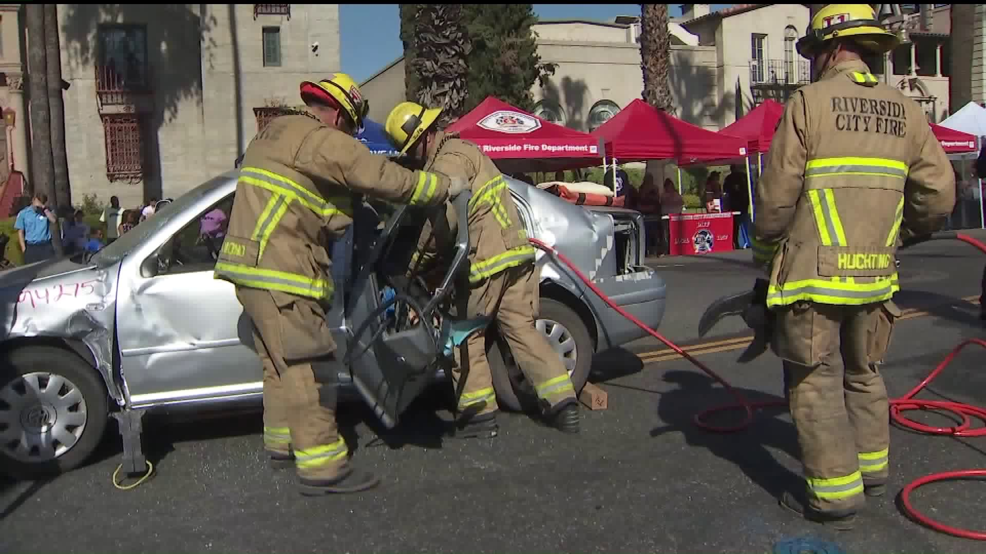 Riverside Fire Department firefighters take part in a demonstration at the Public Safety Expo on Oct. 6, 2019. (Credit: KTLA)