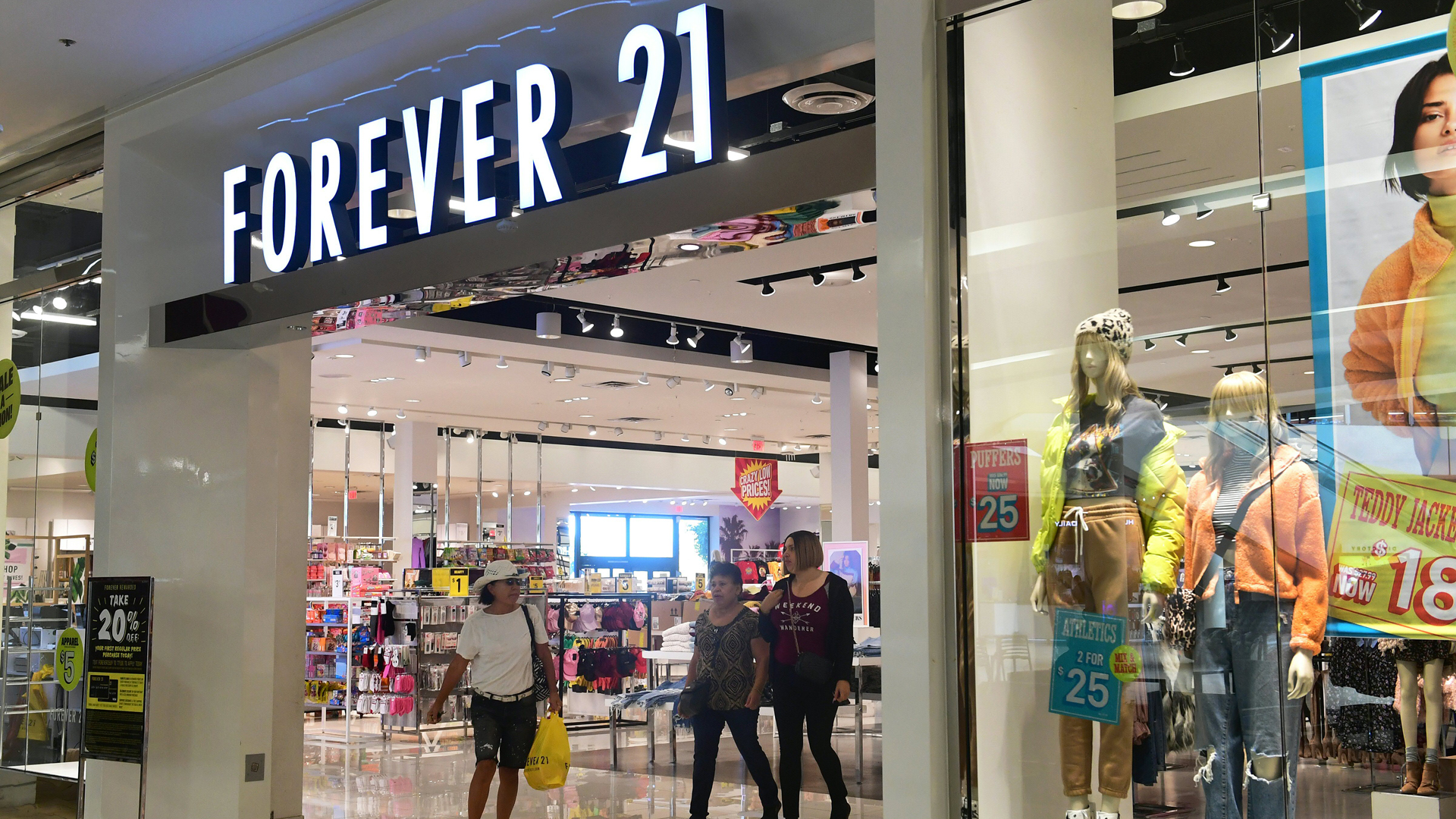 Shopper leave a Forever 21 store at a shopping mall in Los Angeles County on Sep. 30, 2019. (Credit: Frederic J. Brown/AFP/Getty Images)