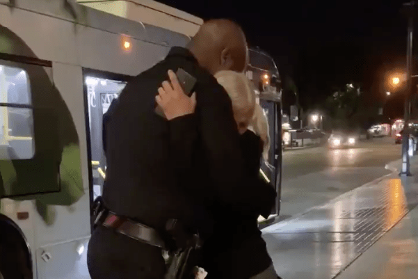 Emily Zamourka hugs Officer Frazier in a video tweeted by Los Angeles police on Oct. 3, 2019.