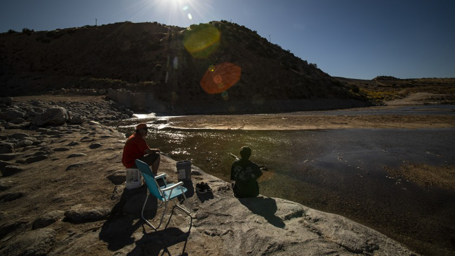 Victorville residents Charles Pritchett, left, and Kyle Carroll enjoy the solitude of the Mojave River just downstream from the Mojave River Dam on Nov. 5, 2019.(Credit: Gina Ferazzi/Los Angeles Times)