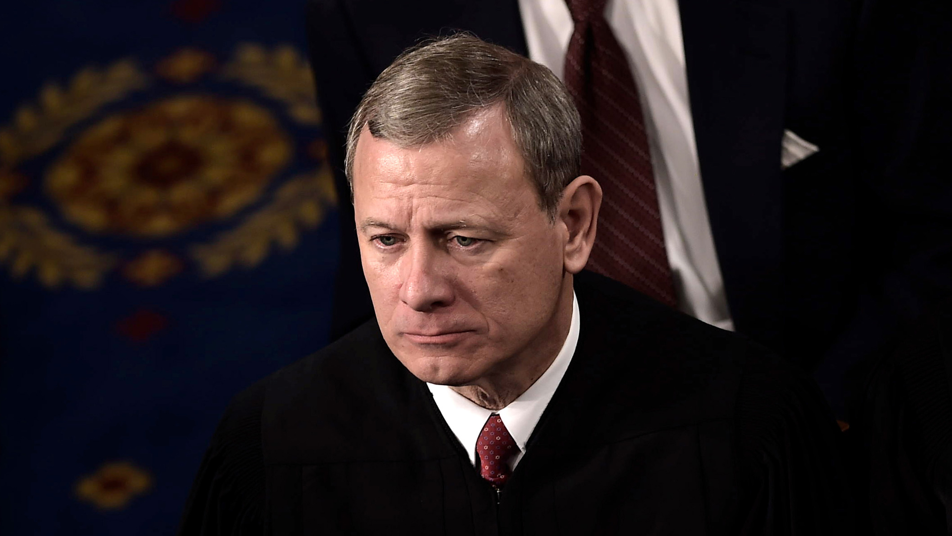 U.S. Supreme Court Justice John G. Roberts Jr. listens as President Donald Trump delivers the State of the Union address at the U.S. Capitol in Washington, D.C., on Jan. 30, 2018. (Credit: BRENDAN SMIALOWSKI/AFP via Getty Images)