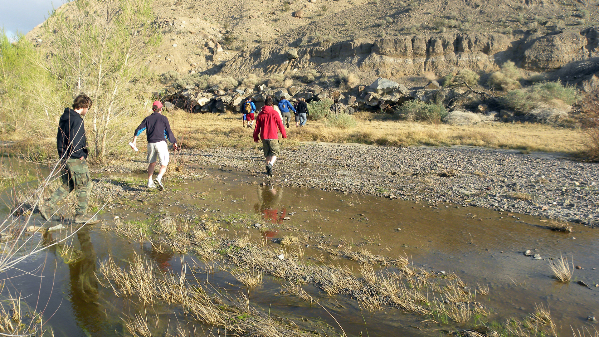 People walk across the Mojave River near Afton Canyon in March 2010. (Credit: Mark A. Wilson / Wikimedia Commons)