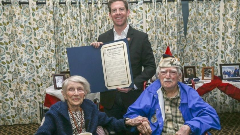"""U.S. Rep. Mike Levin holds the congressional record recognizing married Marine veterans LaVonne """"Bea"""" Walsh, 95, and Joe Walsh, 100, on Joe's 100th birthday in March.(Credit: U.S. Marine Corps via Los Angeles Times)"""